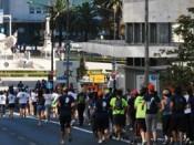 Pessoas a correr junto ao Marquês de Pombal
